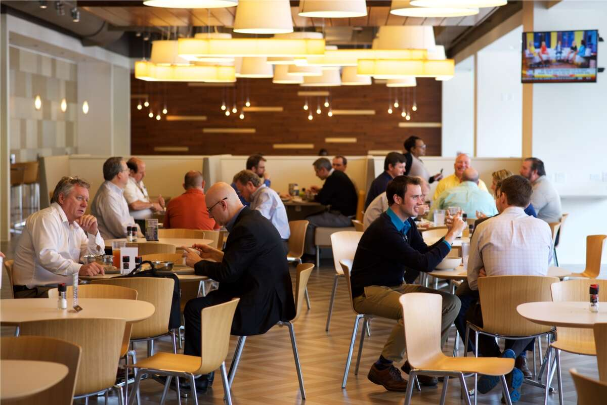 Employees have lunch at Apache's Café 54. Apache Corp. earned a spot on the Chronicle Top Workplaces list for the second year in 2017.