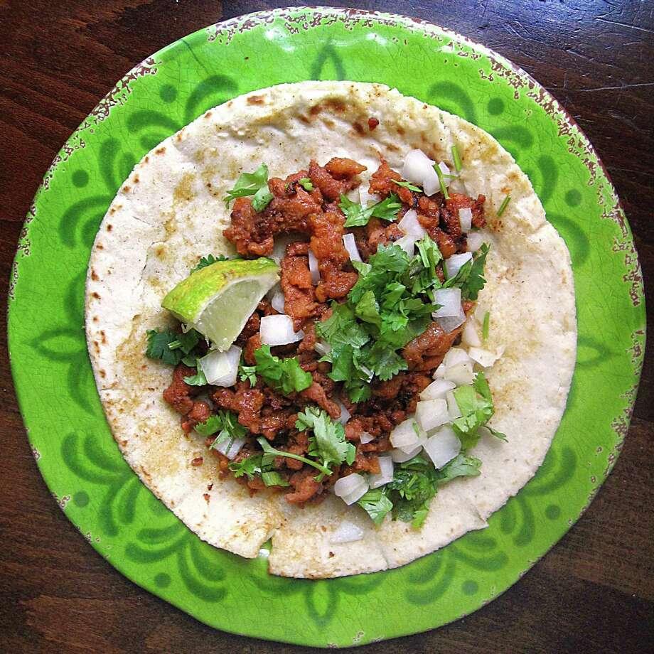 Al pastor taco on a handmade corn tortilla from Sonia's Restaurante Mexicano. Photo: Mike Sutter /San Antonio Express-News