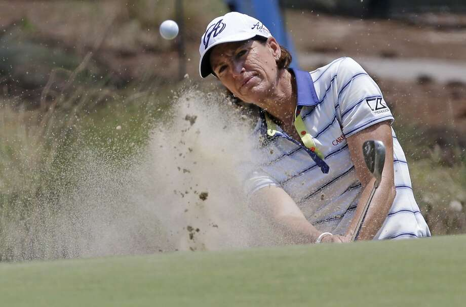 Juli Inkster chips to the 10th green during a practice round for the U.S. Women's Open golf tournament in Pinehurst, N.C., Wednesday, June 18, 2014. (AP Photo/Bob Leverone) Photo: Bob Leverone, AP