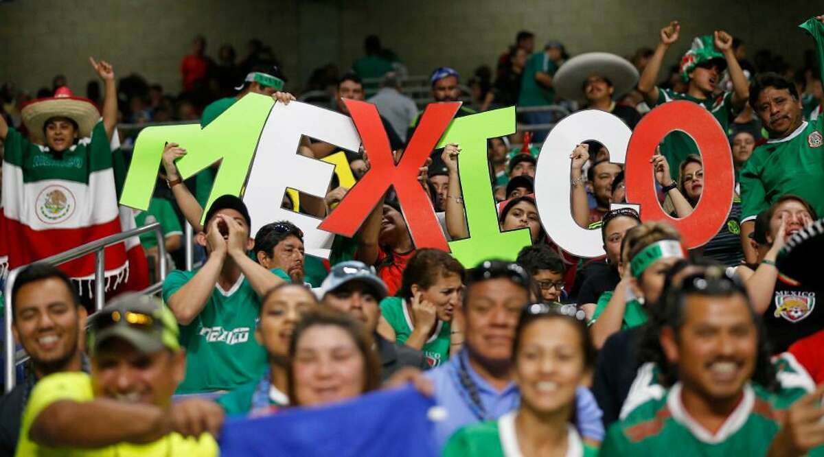 Mexico soccer fans cheer before the CONCACAF Gold Cup soccer match between Mexico and Curacao held Sunday July 16, 2017 at the Alamodome. Mexico won 2-0.