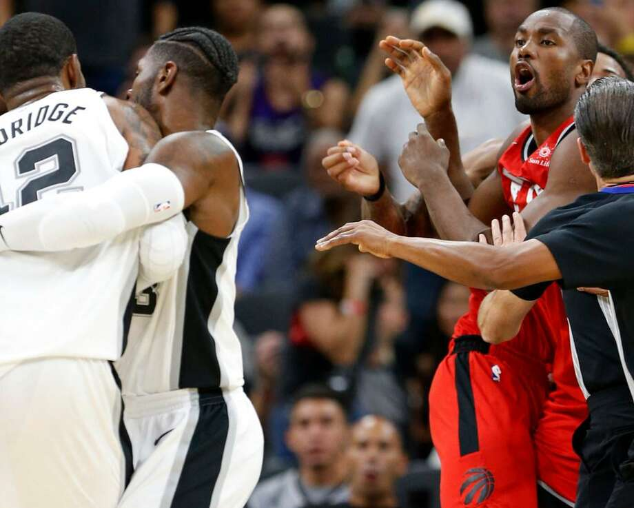 LaMarcus Aldridge (left) and Toronto Raptors' Serge Ibaka are separated after shoving each other during second half action Monday Oct. 23, 2017 at the AT&T Center. Aldridge and Ibaka both received technicals on the play. The Spurs won 101-97. Photo: Edward A. Ornelas /Express-News
