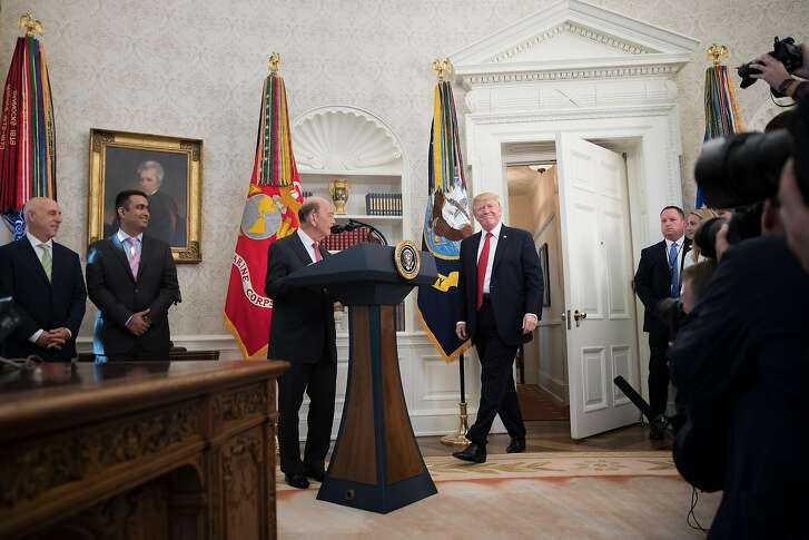 President Donald Trump participates in the Minority Enterprise Development Week awards ceremony in the Oval Office of the White House in Washington, Oct. 24, 2017. Trump started his day on Tuesday with renewed attacks on Sen. Bob Corker, chastising him for his skepticism over a $1.5 trillion tax cut. At center is  Commerce Secretary Wilbur Ross. (Tom Brenner/The New York Times)