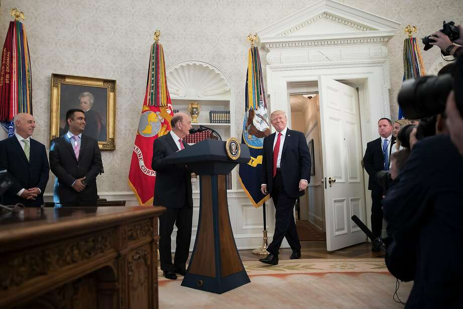 President Donald Trump participates in the Minority Enterprise Development Week awards ceremony in the Oval Office of the White House in Washington, Oct. 24, 2017. Trump started his day on Tuesday with renewed attacks on Sen. Bob Corker, chastising him for his skepticism over a $1.5 trillion tax cut. At center is  Commerce Secretary Wilbur Ross. (Tom Brenner/The New York Times) Photo: TOM BRENNER, NYT