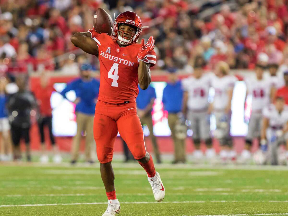 Houston wide receiver Dé?•Eriq King (4) throws a pass to quarterback Kyle Postma for a touchdown in the second quarter of an NCAA college football game at TDECU Stadium on Saturday, Oct. 7, 2017, in Houston, Texas. (Joe Buvid / For the Houston Chronicle)