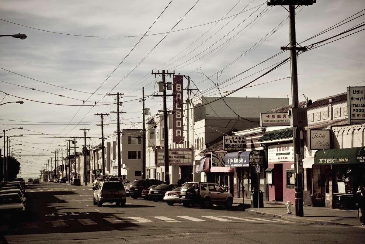 Historic Balboa Theatre and typical restaurants line Balboa Avenue.