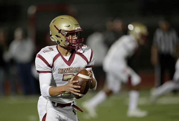Quarterback Beau Barrington (7) looks to throw downfield as Cardinal Newman High School played its first football games against Rancho Cotati High School in Rohnert Park, Calif., Monday, October 23, 2017. The games were the first for the school which was destroyed during the deadly fires that devastated the country and Santa Rosa.