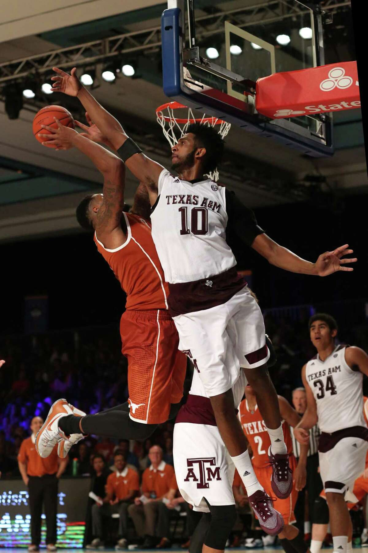 Tonny Torcha-Morelos, #10 of Texas A&M, defends a shot from Cameron Ridley, #55 of the University of Texas. The University of Texas played Texas A&M on November 25th, 2015 in the Battle 4 Atlantis tournament in the Bahamas.