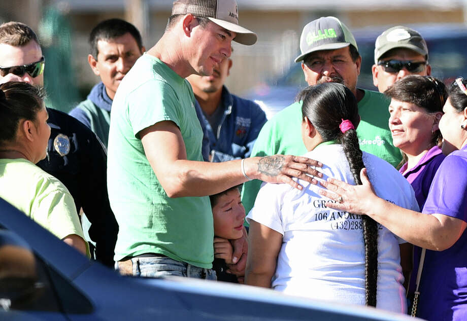 People console each other after a child was hit by a vehicle in the parking lot of Milam Elementary on Oct. 24, 2017. According to a bystander, a large group of people worked together to lift a SUV off a young girl who was trapped underneath. The child was airlifted to Lubbock for her injuries. James Durbin/Reporter-Telegram Photo: James Durbin