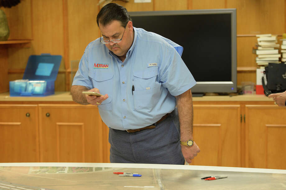 James Beauchamp, President MOTRAN Alliance, looks at diagrams of a Loop 250 overpass project involving County Road 1150 and County Road 60. Photo: James Durbin