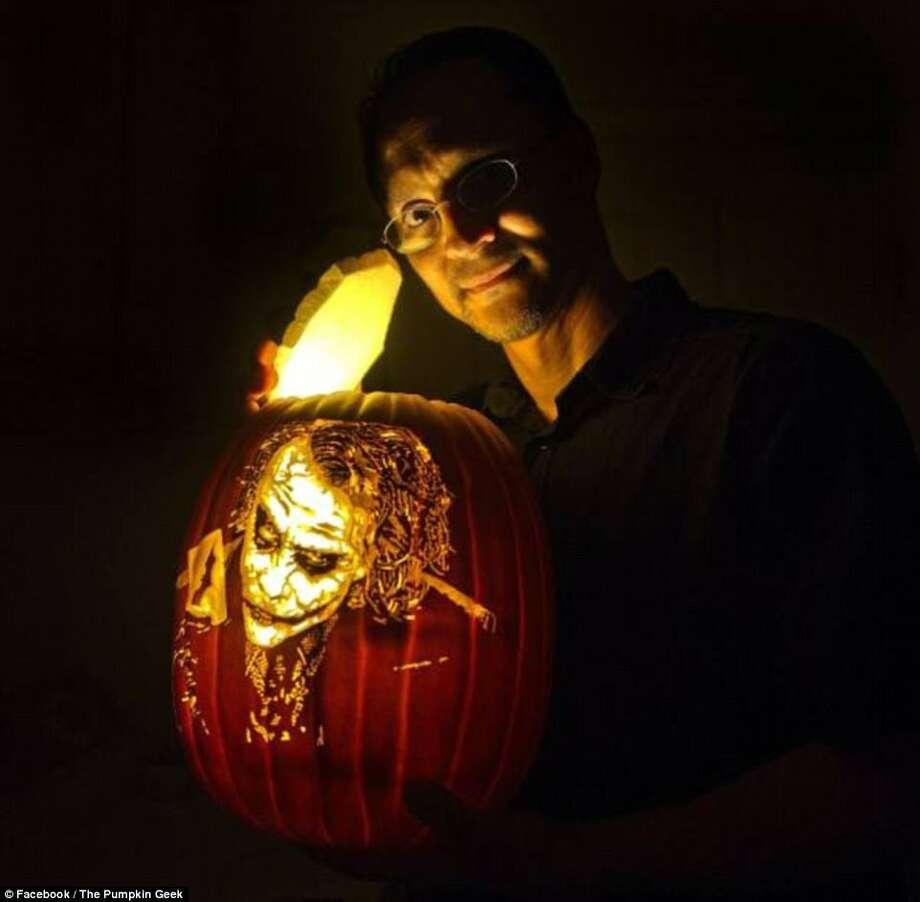 Sacramento artist Alex Wer quit his day job as a mortgage broker to carve artificial pumpkins full-time. His creations range from celebrities to Star Wars battle scenes. Photo: © Facebook / The Pumpkin Geek, Courtesy Alex Wer/@thepumpkingeek