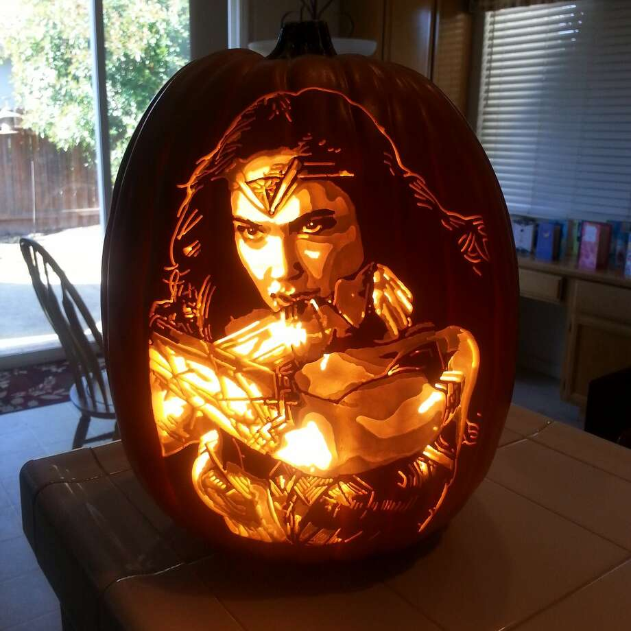 Sacramento artist Alex Wer quit his day job as a mortgage broker to carve artificial pumpkins full-time. His creations range from celebrities to Star Wars battle scenes. Photo: Courtesy Alex Wer/@thepumpkingeek