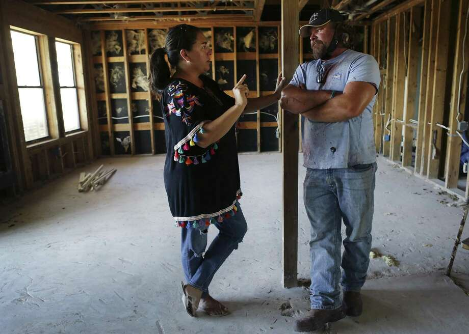 Lisa Mayo talks with her husband Matt Mayo in their gutted home in Channel Vista, in Port Aransas, TX. Mayo also had a business in the small coastal town that was distroyed by hurricane Harvey. Things in the small Texas vacation town of Port Aransas are slowing coming back in operation, on Tuesday, Oct. 24, 2017. Photo: Bob Owen, Staff / San Antonio Express-News / ©2017 San Antonio Express-News