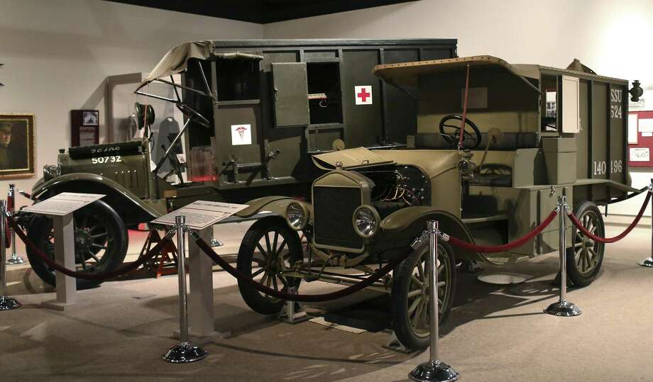 A Model 16 Army Ambulance (left) and a 1916 Model T Ford Ambulance were both used in World War I. They are among the exhibits at the U.S. Army Medical Department Museum at Fort Sam Houston. Photo: Jerry Lara /San Antonio Express-News / © 2017 San Antonio Express-News