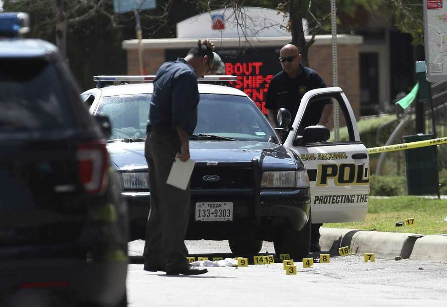 Investigators examine bullet casings on Evergreen Street after police exchanged gunfire with a gunman. The Violent Crime Task Force is being credited with a big increase in arrests. Photo: San Antonio Express-News /File Photo / ©2017 San Antonio Express-News