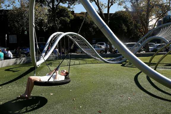 Alexandra Dworsky from San Francisco takes a break during warm weather at South Park on Tuesday October 24, 2017, in San Francisco, Calif.
