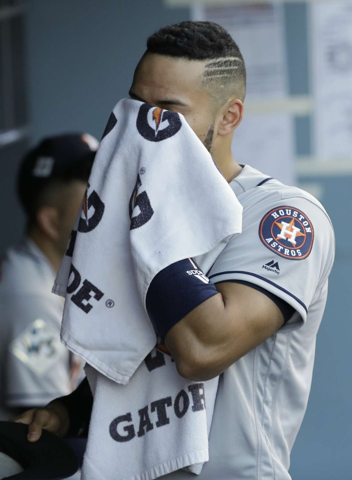 Houston Astros' Carlos Correa wipes his face before Game 1 of baseball's World Series against the Los Angeles Dodgers Tuesday, Oct. 24, 2017, in Los Angeles. Game time temperature in near 100 degrees. (AP Photo/David J. Phillip)