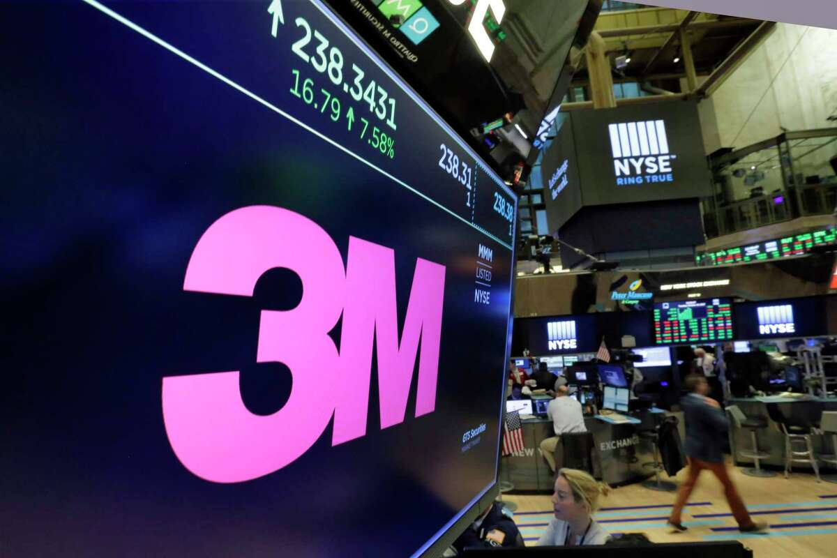 The logo for 3M appears Tuesday on a screen above the New York Stock Exchange's trading floor. The company raised its forecast for the rest of the year.