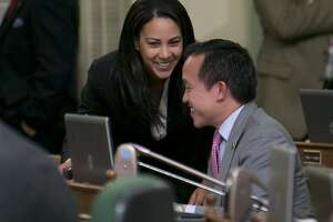 "File - In this May 26, 2015 file photo, Assemblywoman Autumn Burke, D-Inglewood, talks with Assemblyman David Chiu, D-San Francisco, in Sacramento, Calif. Women lawmakers, lobbyists and staffers in California's Capitol are encouraging each other to share stories of sexual harassment in the workplace in an effort to show its pervasiveness and to ensure more men stand up against it. ""It was just really important that we start to talk about a culture and a change in culture,"" said Assemblywoman Burke. (AP Photo/Rich Pedroncelli, File)"