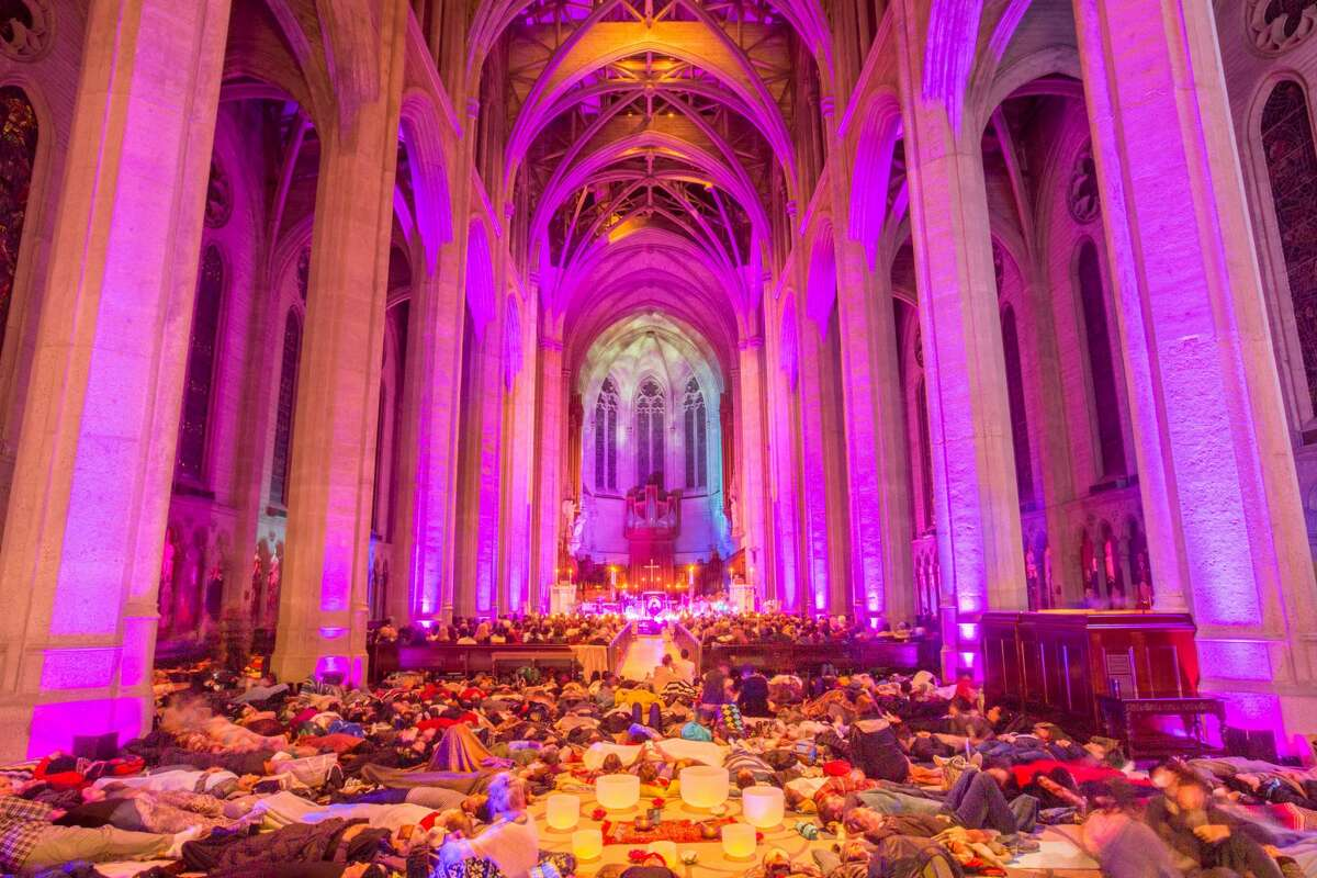 People meditate during a Sound Healing Symphony, organized by Sound Meditation SF at Grace Cathedral in San Francisco.