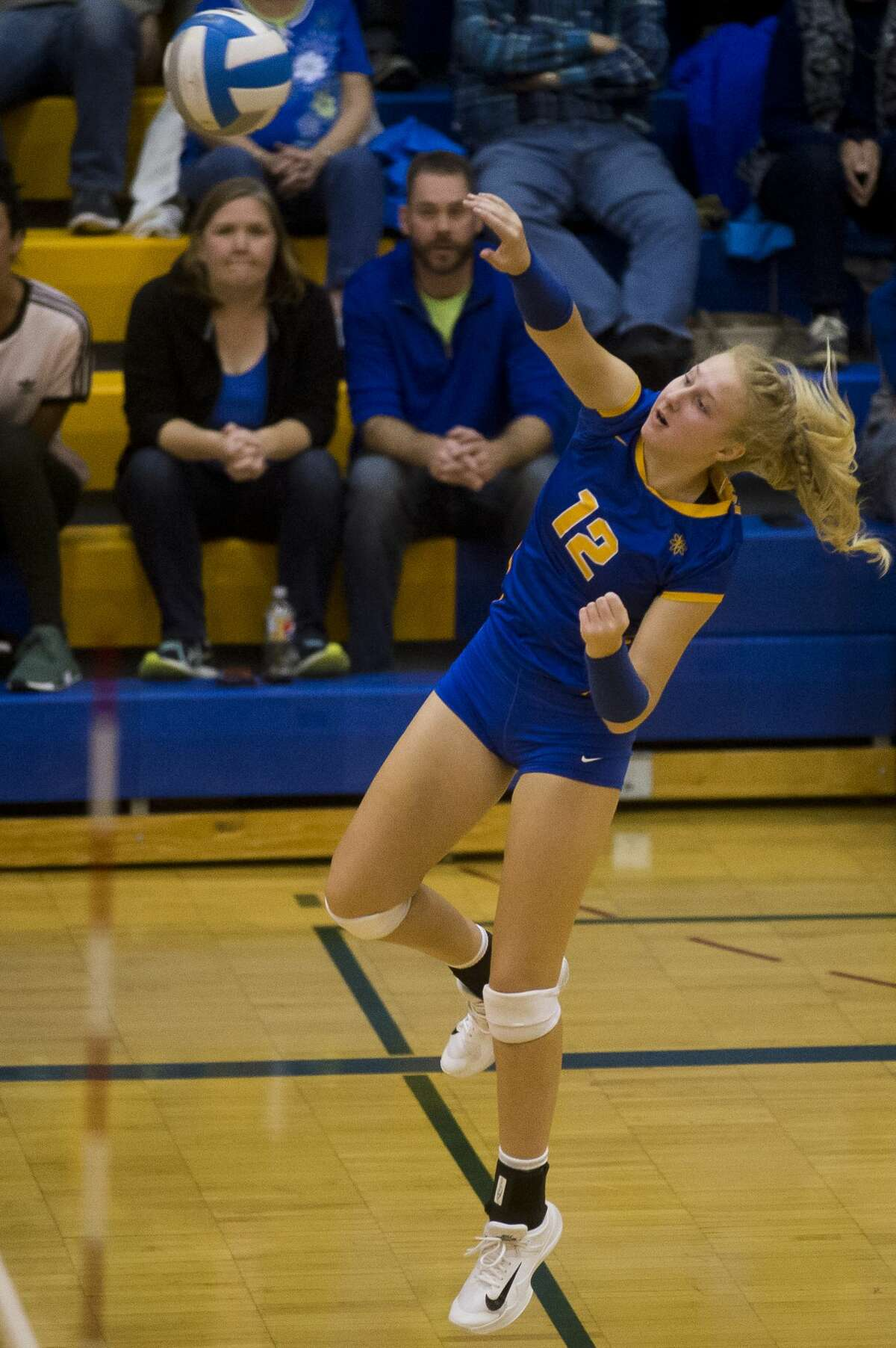 Midland junior Maya Albright spikes the ball during a match against Dow on Tuesday, Oct. 24, 2017 at Midland High. (Katy Kildee/kkildee@mdn.net)