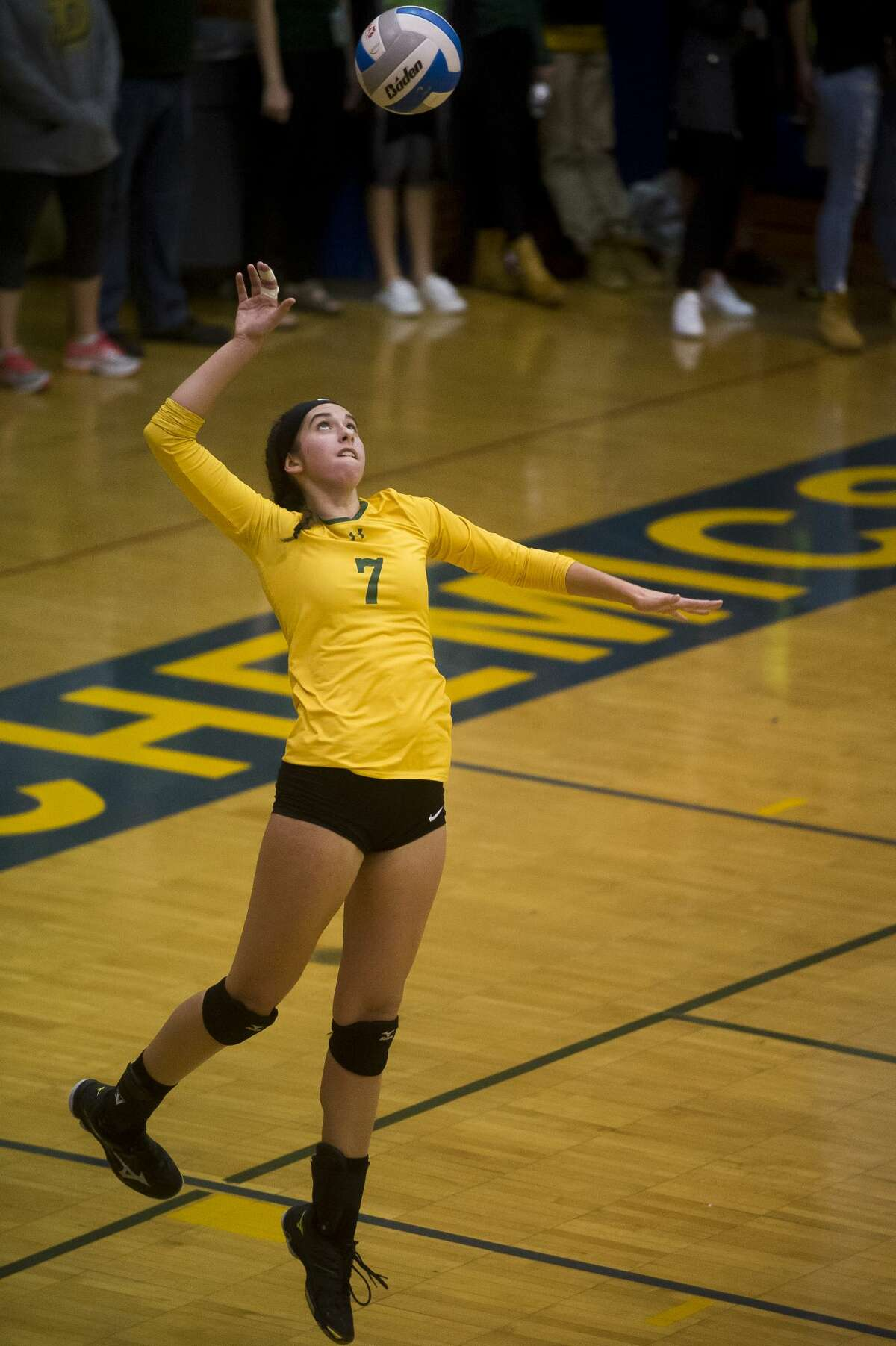Dow sophomore Hailey Tanis serves the ball during a match against Midland on Tuesday, Oct. 24, 2017 at Midland High. (Katy Kildee/kkildee@mdn.net)