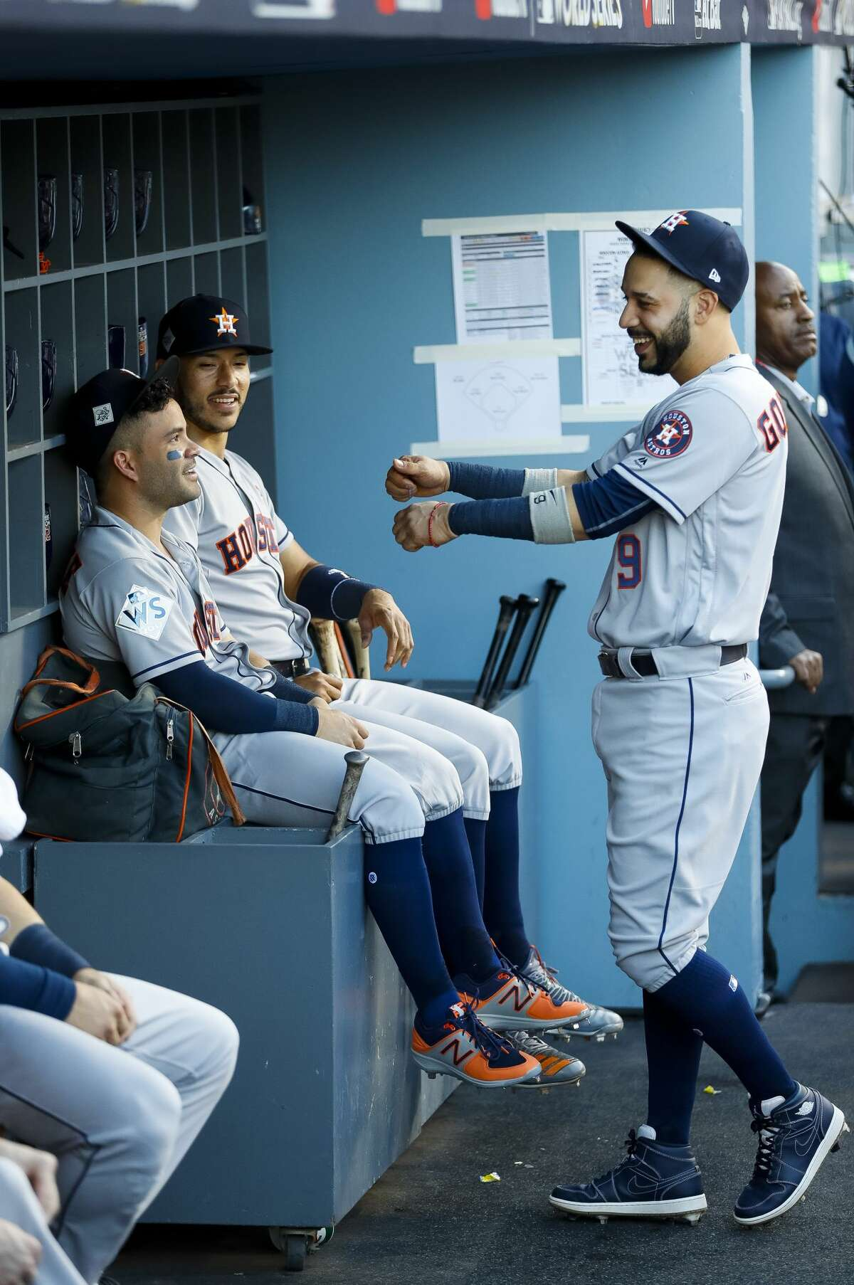 Houston Astros second baseman Jose Altuve (27), shortstop Carlos Correa (1) and left fielder Marwin Gonzalez (9) talk in the dugout before the beginning of Game 1 of the World Series at Dodger Stadium on Tuesday, Oct. 24, 2017, in Los Angeles. ( Karen Warren / Houston Chronicle )