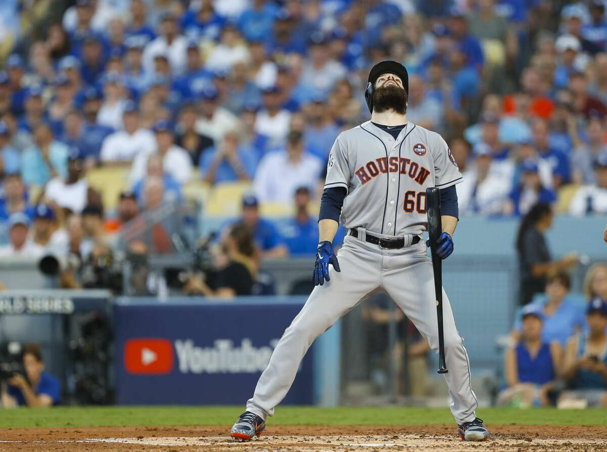 Houston Astros starting pitcher Dallas Keuchel (60) strikes out on a foul bunt during the third inning of Game 1 of the World Series at Dodger Stadium on Tuesday, Oct. 24, 2017, in Los Angeles. ( Brett Coomer / Houston Chronicle )