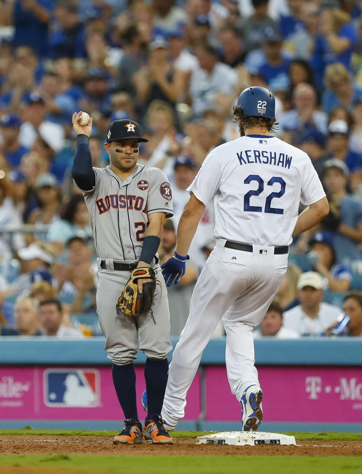 Houston Astros second baseman Jose Altuve (27) forces Los Angeles Dodgers starting pitcher Clayton Kershaw (22) out at first during the third inning of Game 1 of the World Series at Dodger Stadium on Tuesday, Oct. 24, 2017, in Los Angeles. ( Brett Coomer / Houston Chronicle )