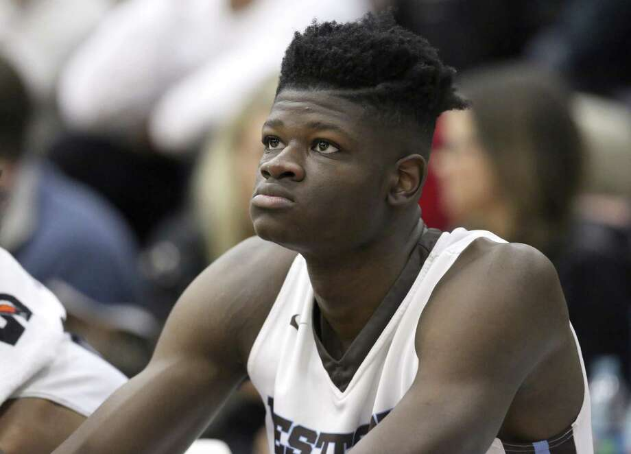 FILE - In this Jan. 14, 2017, file photo, Westtown School's Mo Bamba watches from the bench during a high school basketball game against Hillcrest Prep at the 2017 Hoophall Classic in Springfield, Mass. The older brother of Texas basketball recruit Mo Bamba, one of the top incoming players in the country next season, says Bamba took improper gifts and money from a Detroit financial adviser that would make him ineligible to play in college. Texas says Bamba's amateur status had previously been reviewed by the NCAA and he's been cleared to play (AP Photo/Gregory Payan, File) Photo: Gregory Payan, STF / Associated Press / The Citizen