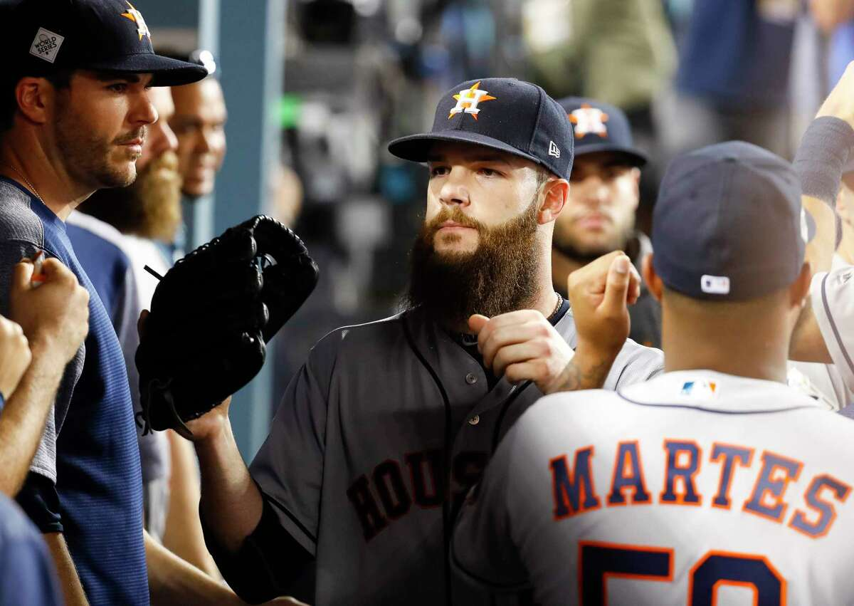 Houston Astros starting pitcher Dallas Keuchel (60) is welcomed back to the dugout in the seventh inning of Game 1 of the World Series at Dodger Stadium on Tuesday, Oct. 24, 2017, in Los Angeles.