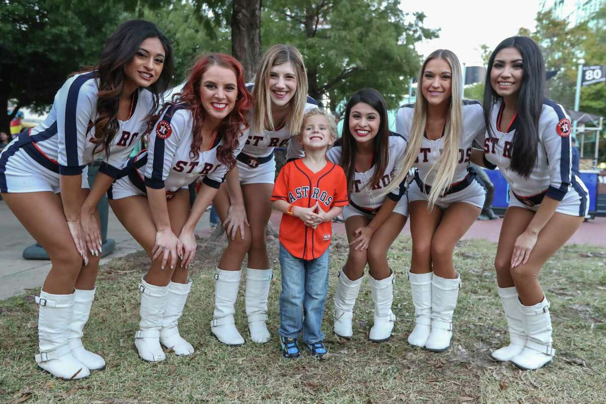 Paxton Miley, 3, has his photo taken with what he calls