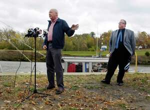 Town of Waterford Supervisor, John Lawler, left, and Town of Halfmoon Supervisor, Kevin Tollisen voice their concerns over a possible expansion of the Colonie Landfill during a press conference near the Erie Canal on Tuesday, Oct. 24, 2017, in Waterford, N.Y.  (Paul Buckowski / Times Union)