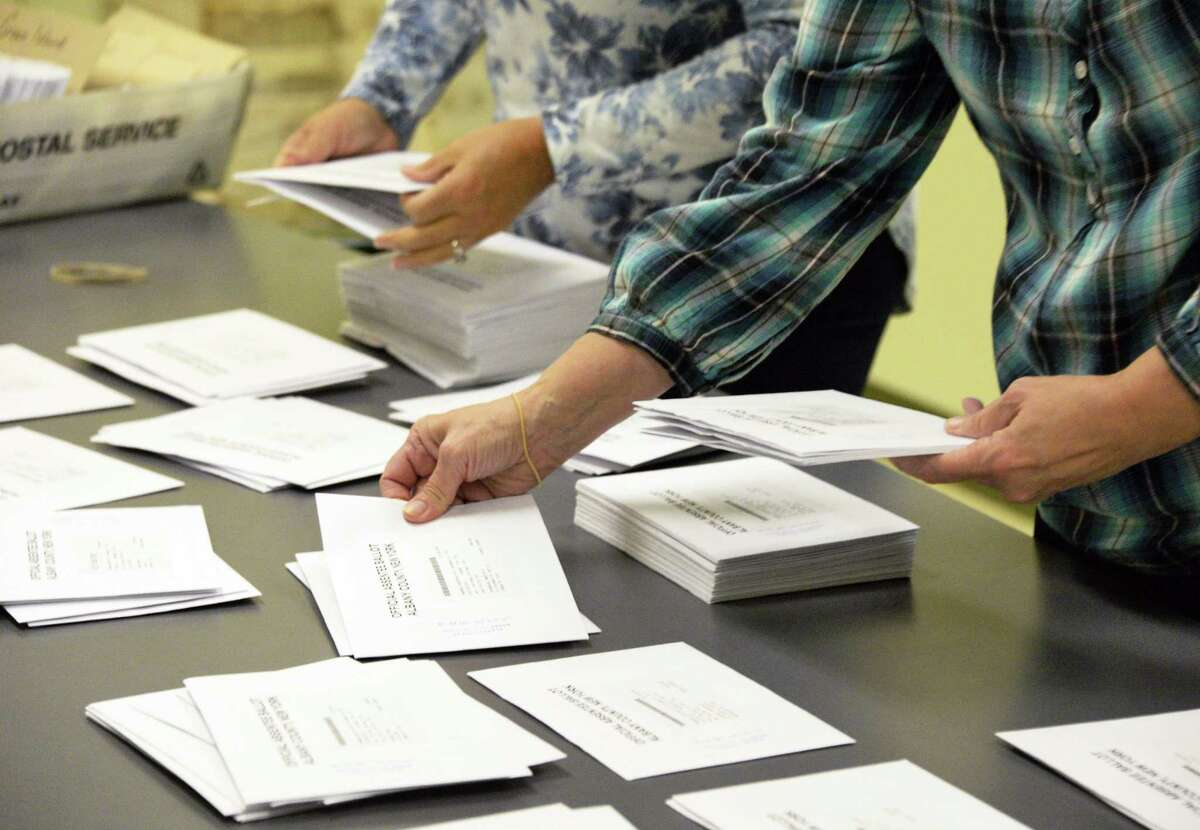 Supervising election specialists process absentee ballots at the Albany County Board of Elections Tuesday Oct. 24, 2017 in Albany, NY. (John Carl D'Annibale / Times Union)