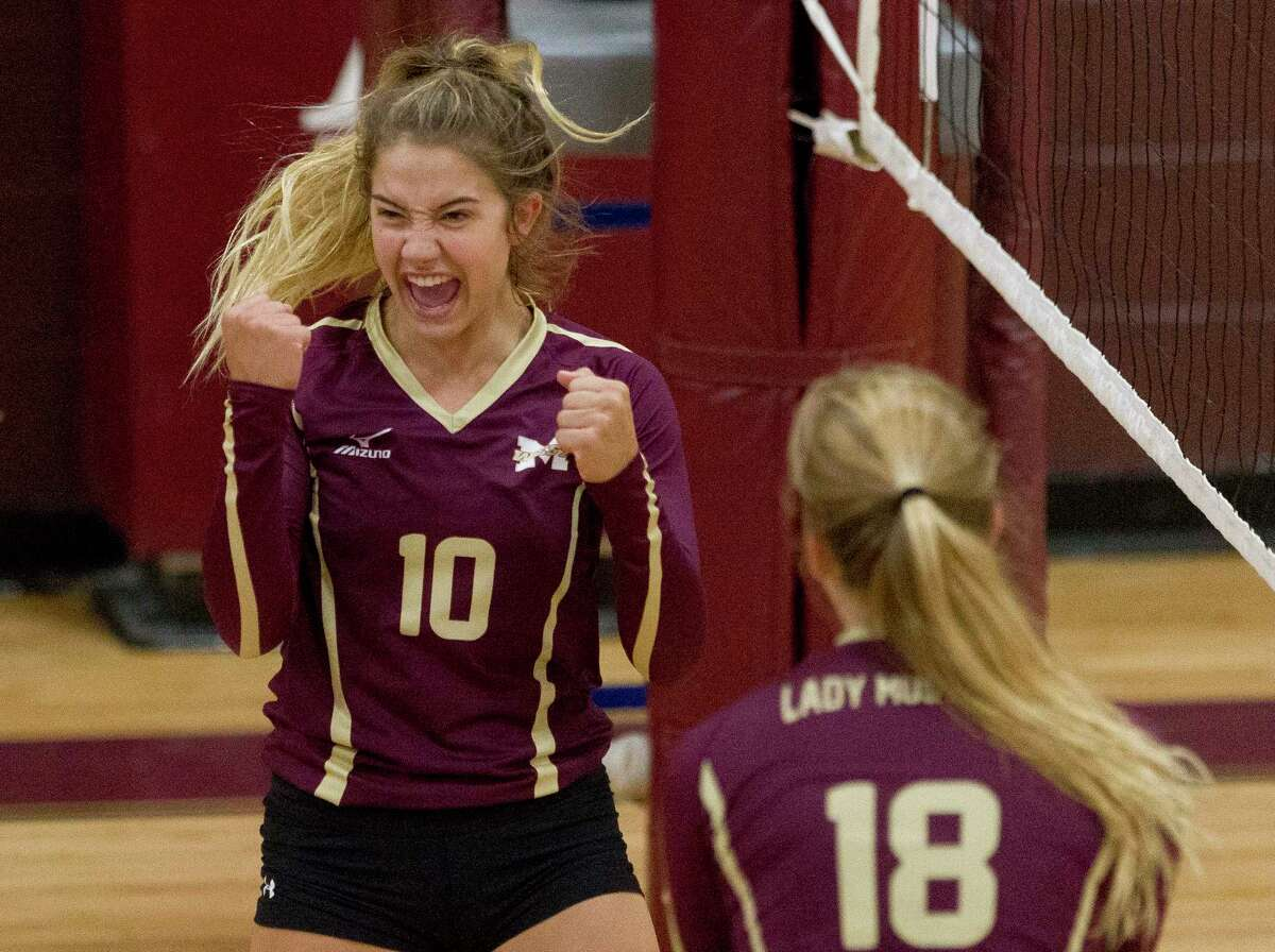 Magnolia West's Rylie Scales (10) celebrates a point during a match in the Cy-Fair/Katy Volleyball Classic, Thursday, Aug. 10, 2017, in Cypress.