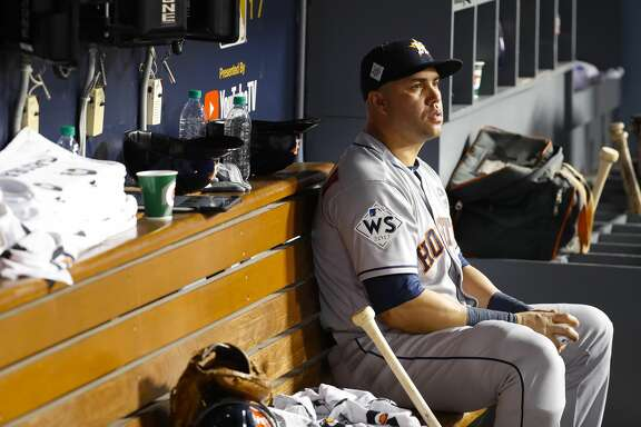 Houston Astros designated hitter Carlos Beltran (15) sits in the dugout during the seventh inning of Game 1 of the World Series at Dodger Stadium on Tuesday, Oct. 24, 2017, in Los Angeles. ( Karen Warren  / Houston Chronicle )