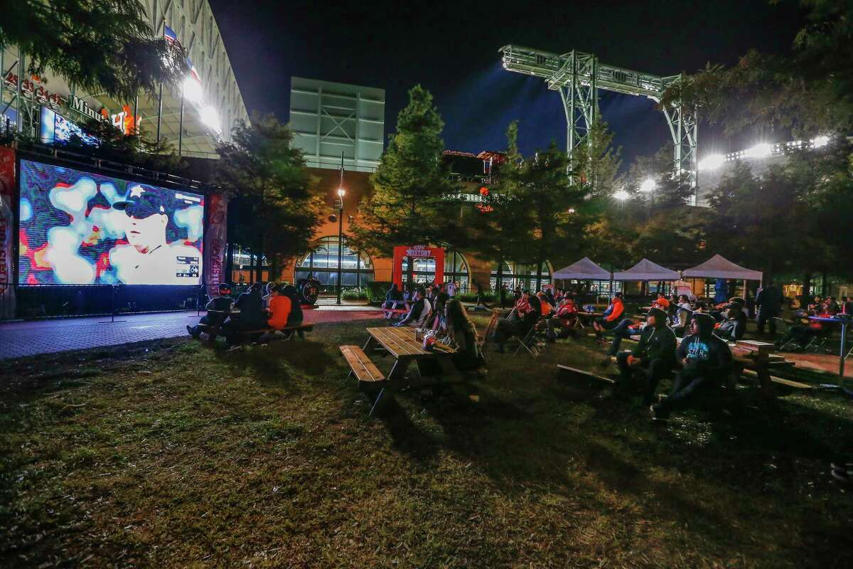 Astros fans watched the World Series Game One on a large screen outside Minute Maid Park Tuesday, Oct. 24, 2017, in Houston.