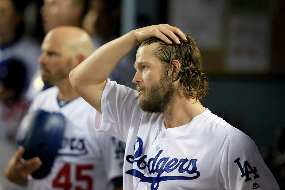 LOS ANGELES, CA - OCTOBER 24:  Clayton Kershaw #22 of the Los Angeles Dodgers looks on in the dugout during the seventh inning against the Houston Astros in game one of the 2017 World Series at Dodger Stadium on October 24, 2017 in Los Angeles, California.  (Photo by Sean M. Haffey/Getty Images) Photo: Sean M. Haffey, Staff / Getty Images / 2017 Getty Images