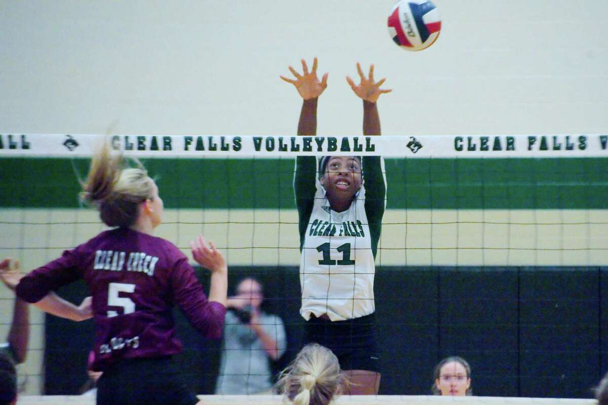 Clear Falls' Rachel Brown (11) tris to block a shot by Clear Creek Tuesday, Oct. 24 at Clear Falls High School.
