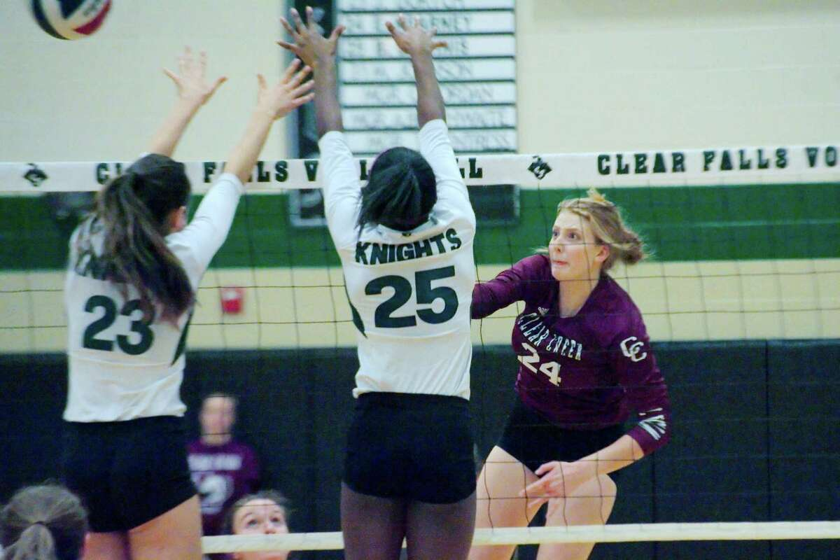 Clear Creek's Jenna Metzinger (24) tries to hit a shot past Clear Falls' Jordan Dortch (23) and Clear Falls' Brianna Daphnis (25) Tuesday, Oct. 24 at Clear Falls High School.