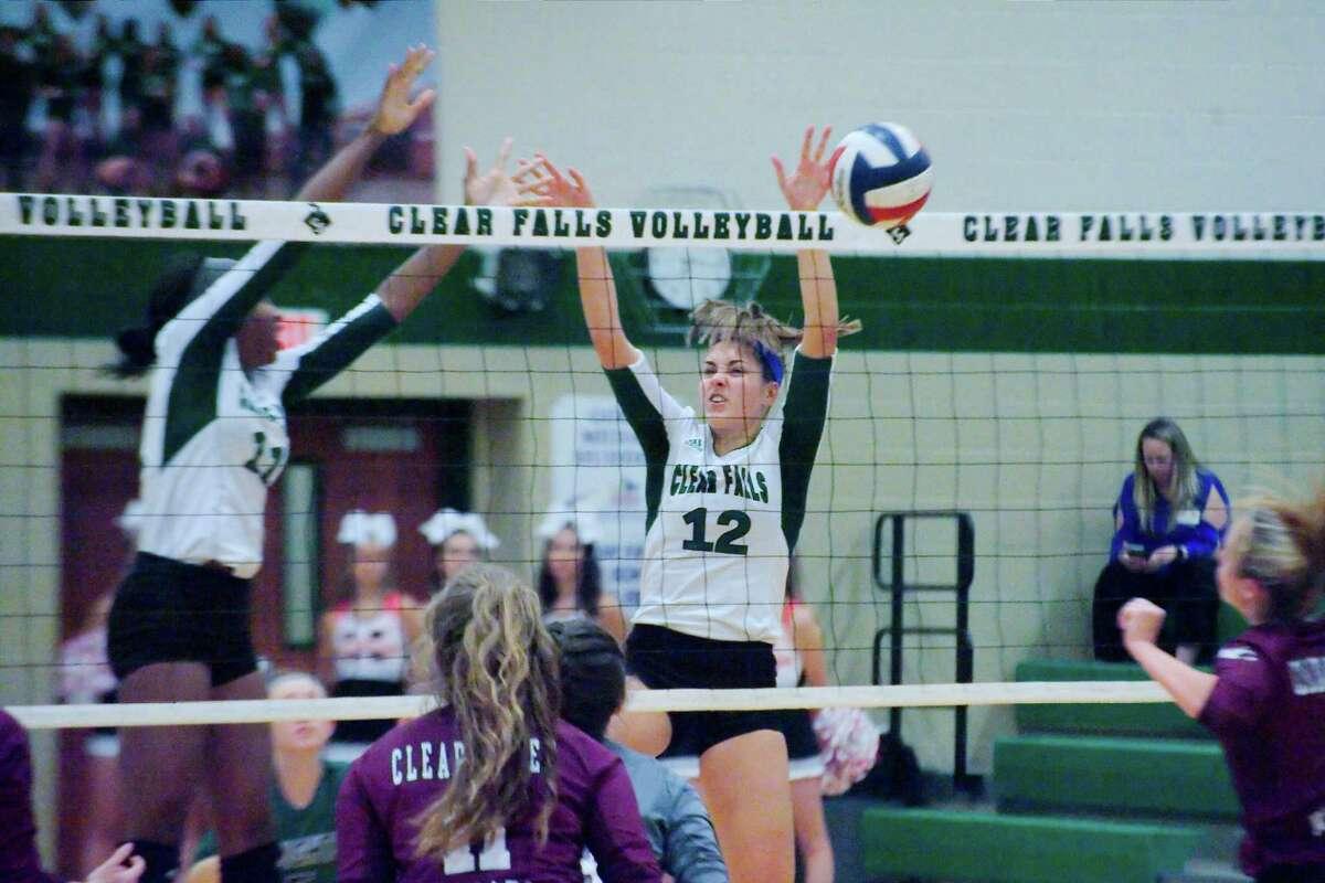 Clear Falls' Rachel Brown (11) and Clear Falls' Briana Garcia (12) block a shot by Clear Creek Tuesday, Oct. 24 at Clear Falls High School.