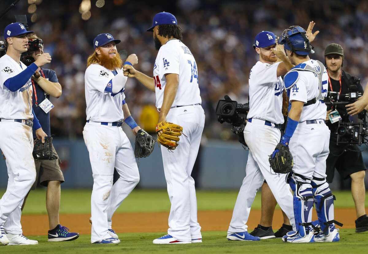 The Dodgers celebrate their win in Game 1 of the World Series at Dodger Stadium on Tuesday, Oct. 24, 2017, in Los Angeles. ( Brett Coomer / Houston Chronicle )
