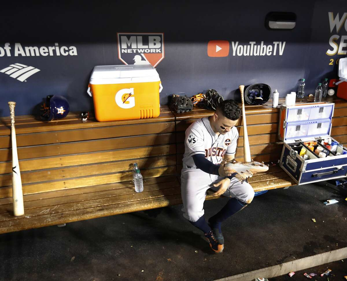 Houston Astros Jose Altuve (27) kicks dirt out of his shoes before his last at bat in the ninth inning of Game 1 of an MLB World Series at Dodger Stadium, Tuesday, Oct. 24, 2017, in Los Angeles. ( Karen Warren / Houston Chronicle )