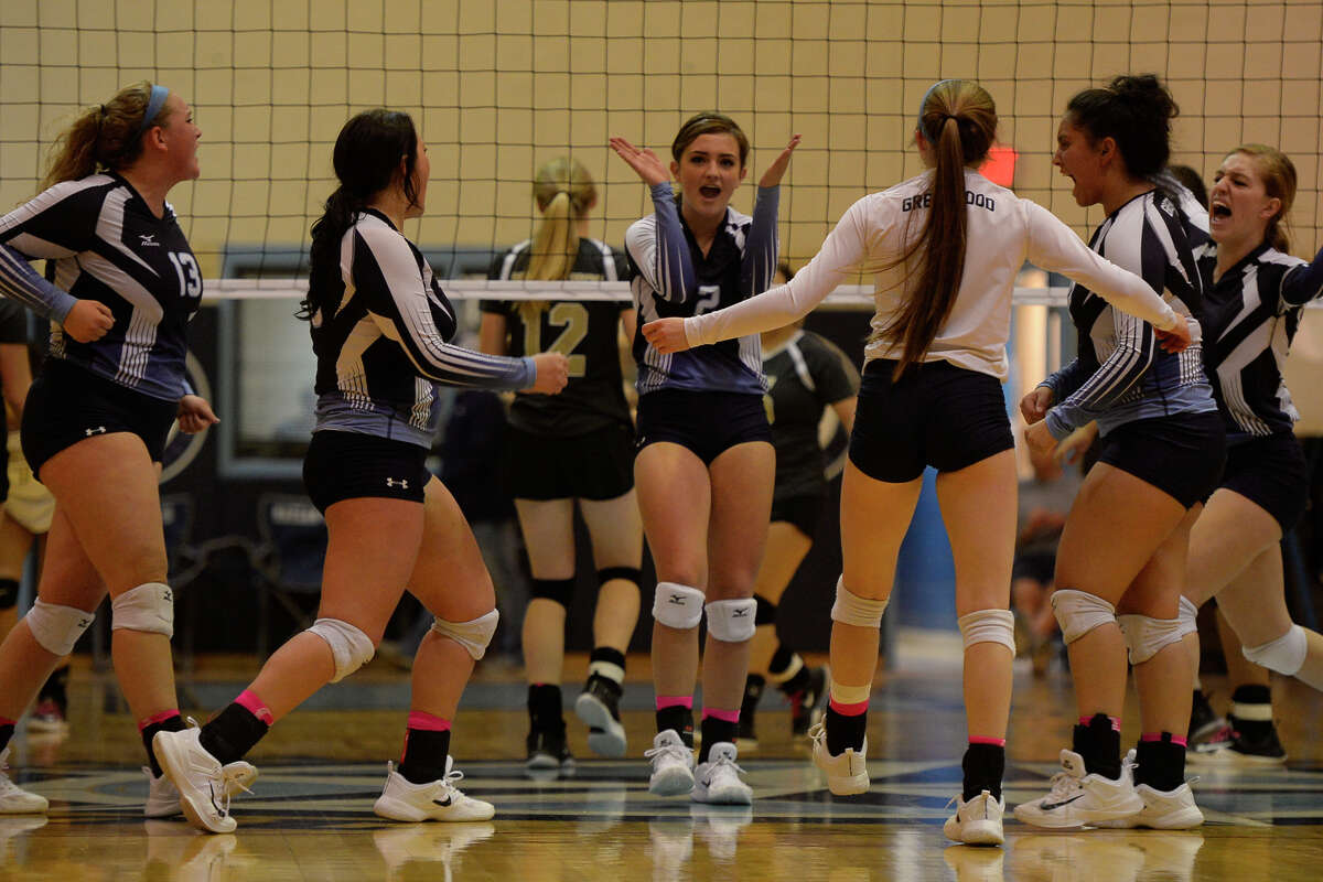 Greenwood volleyball players celebrate after scoring against Andrews Oct. 24, 2017, at Greenwood High School James Durbin/Reporter-Telegram