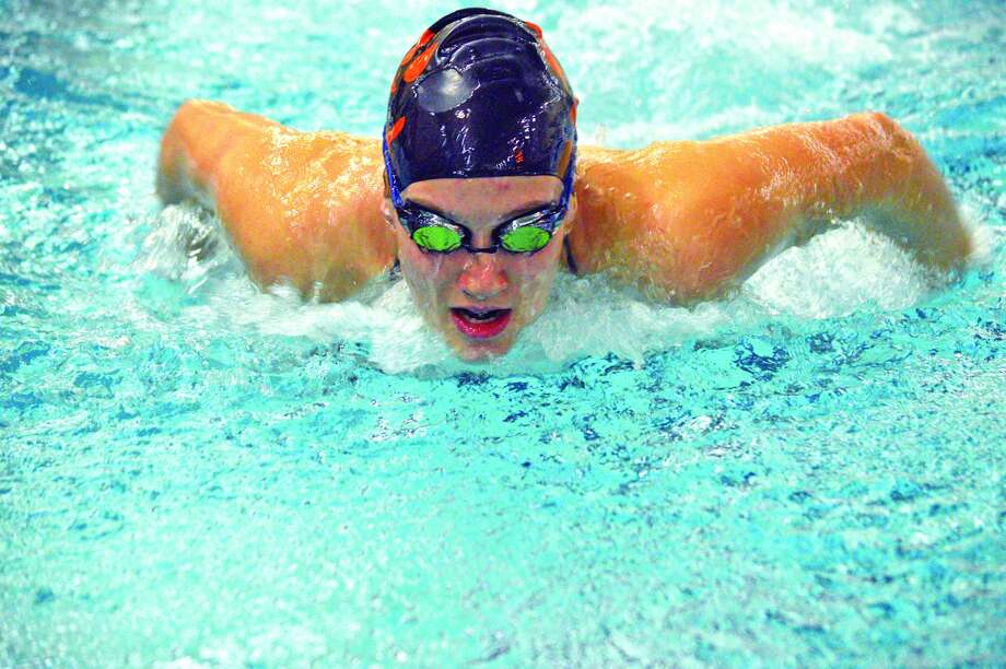 Edwardsville sophomore Josie Bushell practices the butterfly on Monday inside the Chuck Fruit Aquatic Center.