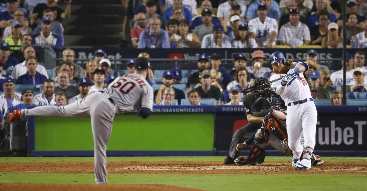 Los Angeles Dodgers third baseman Justin Turner (10) hits a two-run home run off of Houston Astros starting pitcher Dallas Keuchel (60) during the sixth inning of Game 1 of the World Series at Dodger Stadium on Tuesday, Oct. 24, 2017, in Los Angeles. ( Michael Ciaglo / Houston Chronicle )