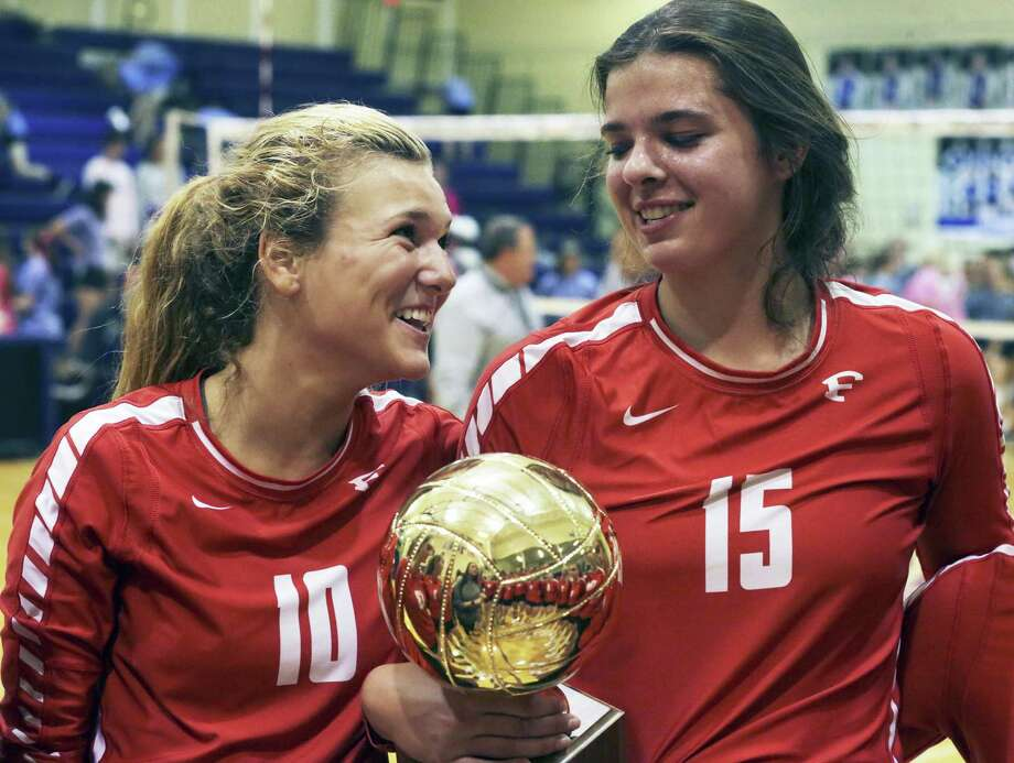 Aubrey Sultemeier (15) and Molly Pluenneke hold the district trophy after winning in a 28-4A volleyball match between Boerne and Fredericksburg at Boerne High School on October 24, 2017. Photo: Tom Reel, Staff / San Antonio Express-News / 2017 SAN ANTONIO EXPRESS-NEWS