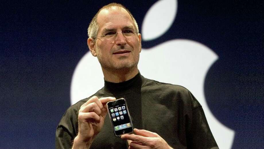 Steve Jobs introduces the iPhone in 2007, kicking off the modern smartphone era.  Photo: David Paul Morris | Getty Images