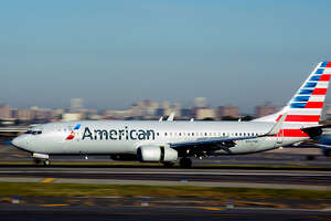 NEW YORK, NY - OCTOBER 4, 2017:  An American Airlines passenger jet (Boeing 737) lands at LaGuardia Airport in New York, New York. (Photo by Robert Alexander/Getty Images)