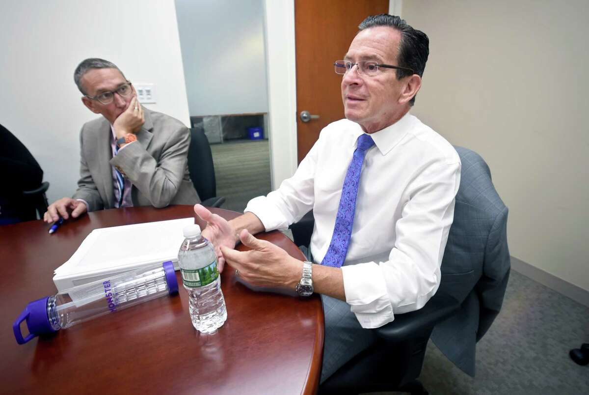 Connecticut coffers would have been $3 billion fatter per year if the growth rate of tax collection in the Malloy era had matched the early to mid-2000's, and that means state budget shortfalls would not exist at all. In a file photo, Gov. Dannel Malloy is shown with his budget chief, Ben Barnes, left, secretary of the Office of Policy and Management.