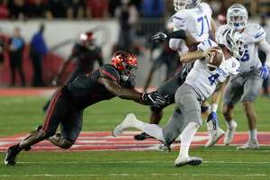 Memphis Tigers quarterback Riley Ferguson #4 scrambles to avoid the tackle by Houston Cougars linebacker Austin Robinson #22 in the fourth quarter during the NCAA football game between the Memphis Tigers and the Houston Cougars at TDECU Stadium in Houston, TX on Thursday, October 19, 2017.
